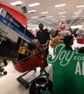"""Thanksgiving Day shoppers push loaded up carts during the """"Black Friday"""" sales at a Target store in Culver City, California on November 24, 2016.  US retailers kicked off the unofficial start of the holiday retail season with sales that begin on the Thanksgiving holiday. / AFP PHOTO / Mark RALSTON"""