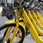 (171026) -- SYDNEY, Oct. 26, 2017 (Xinhua) -- Photo taken on Oct. 26, 2017 shows ofo bikes in Sydney, Australia. China's bike-share company Ofo has launched operation in Sydney on Thursday. Already in 180 cities across 17 countries, the pedal-powered Chinese giant generates over 32 million transactions every day with its 10 million bikes.(Xinhua/Bai Xuefei) (yy)