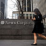 NEW YORK, NY - APRIL 19: A woman walks past the News Corp. and Fox News headquarters in Midtown Manhattan, April 19, 2017 in New York City. Fox News television personality Bill O'Reilly's future at the network is uncertain following numerous claims of sexual harassment and subsequent legal settlements. Drew Angerer/Getty Images/AFP == FOR NEWSPAPERS, INTERNET, TELCOS & TELEVISION USE ONLY ==