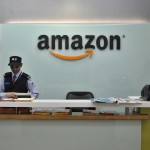 FILE PHOTO: Security guards stand at the reception desk of the Amazon India office in Bengaluru, India, August 14, 2015. REUTERS/Abhishek N. Chinnappa/File Photo