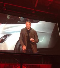 Tesla CEO Elon Musk is shown on a large screen as he unveils the Tesla Semi, his company's new electric semi truck, during a presentation in Hawthorn, California, U.S., November 16, 2017.      REUTERS/Alexandria Sage