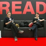 Two women read books in a sofa at the Frankfurt Book Fair 08 October 2003. The fair, the biggest event in the publishing world calendar, opened 07 October with a twin aim of showcasing modern Russian literature and invigorating a moribund industry. AFP PHOTO DDP/OLIVER LANG GERMANY OUT