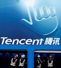 FILE PHOTO: Dancers perform underneath the logo of Tencent at the Global Mobile Internet Conference in Beijing May 6, 2014.   REUTERS/Kim Kyung-Hoon/File Photo     TPX IMAGES OF THE DAY
