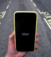 FILE PHOTO: The Uber application is seen on a mobile phone in London