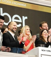 NEW YORK, NEW YORK - MAY 10: Uber CEO Dara Khosrowshahi (center) joins other employees in ringing the Opening Bell at the New York Stock Exchange (NYSE) as the ride-hailing company Uber makes its highly anticipated initial public offering (IPO) on May 10, 2019 in New York City. Uber will start trading on the New York Stock Exchange after raising $8.1 billion in the biggest U.S. IPO in five years.Thousands of Uber and other app based drivers protested around the country on Wednesday to demand better pay and working conditions including sick leave, overtime and a minimum wage.   Spencer Platt/Getty Images/AFP